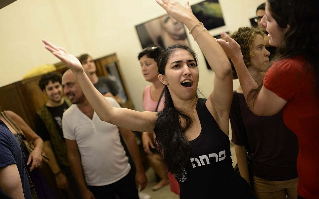 Social activists celebrate at a 'Black Night' party in south Tel Aviv on Thursday, protesting the neglect of the city's low-income neighborhoods (photo credit: Tomer Neuberg/ Flash 90)
