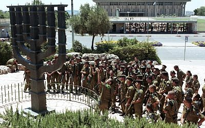 Israel soldiers gather around a large Menorah standing outside the Knesset in 2001. (photo credit: Nati Shohat/Flash90)