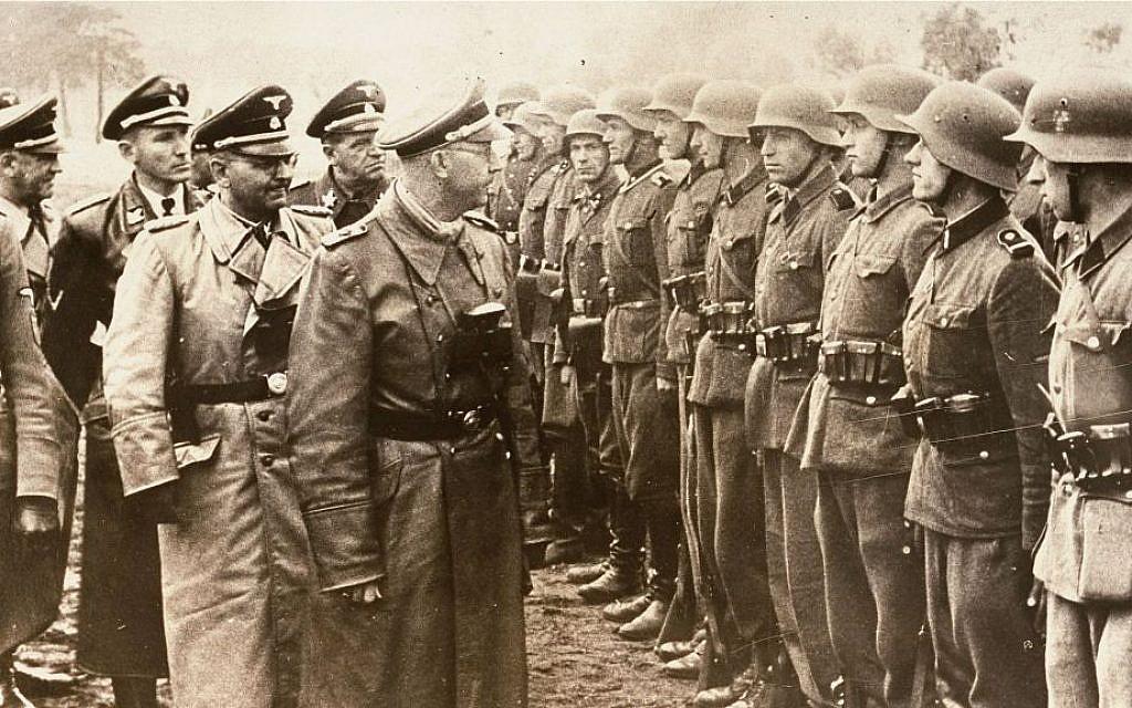 Heinrich Himmler, center, reviews troops of the Galician SS-Volunteer Infantry Division, June 3, 1944. (AP/US Holocaust Memorial Museum, Courtesy of Atlantic Foto Verlag Berlin)