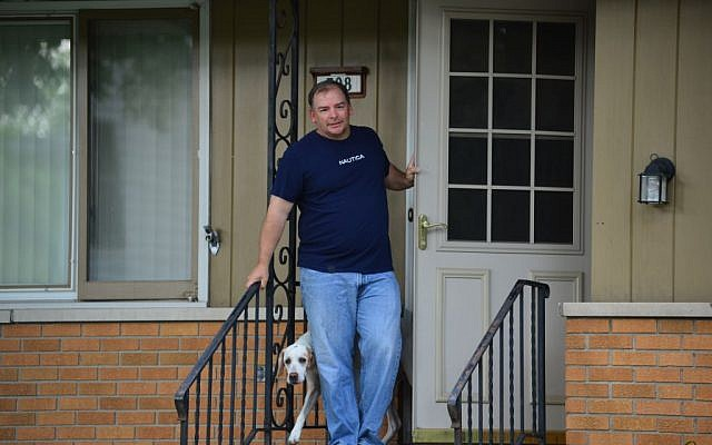 A man who owns the house where Michael Karkoc lived in Minneapolis said that he wasn't home on Friday, June 14. (photo credit: AP/The Star Tribune, Richard Sennott)