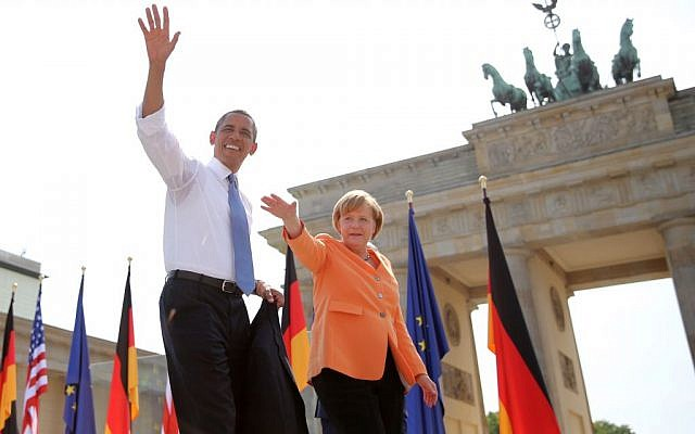 US President Barack Obama and German Chancellor Angela Merkel wave to spectators before Obama delivers a speech in front of the Brandenburg Gate at Pariser Platz in Berlin, Germany, Wednesday June 19, 2013. (AP/Michael Kappeler)