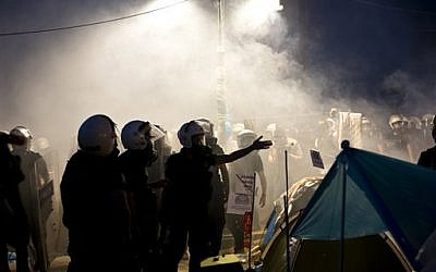 Riot police gather in Gezi park, engulfed in tear gas, in Istanbul, Turkey, Saturday, June 15, 2013 (photo credit: AP Photo/Vadim Ghirda)