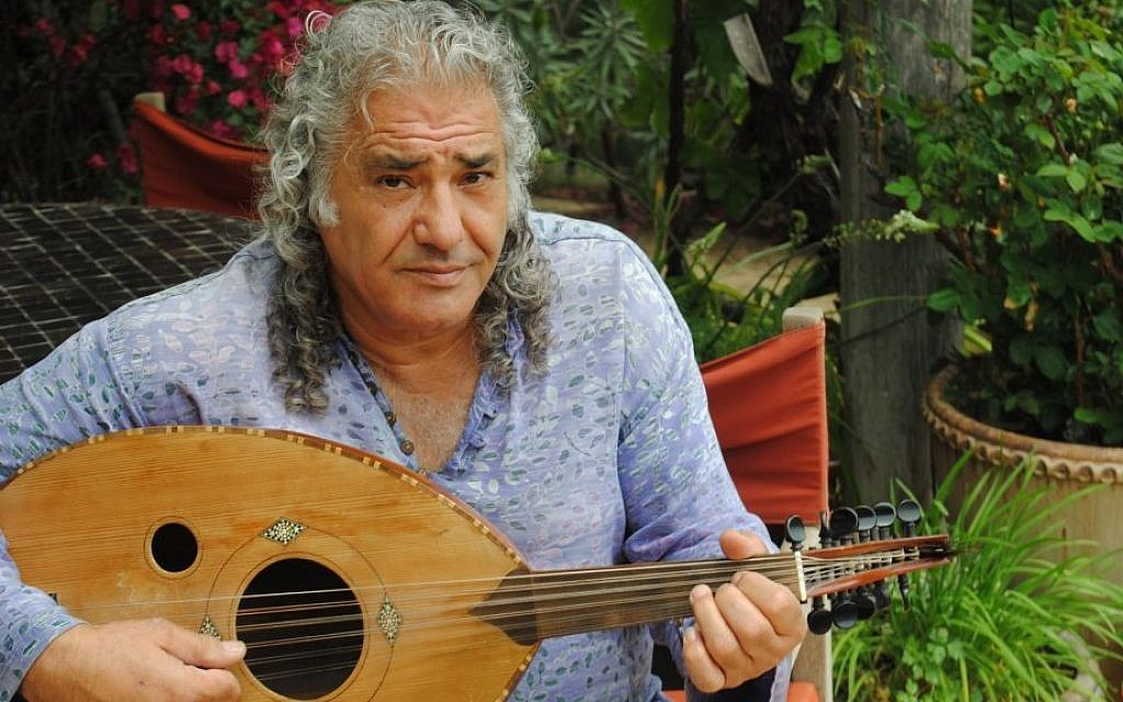Hani Naser began playing the oud at 7 and still has the same nearly 70-year-old instrument. (photo credit: Rebecca Spence/JTA)