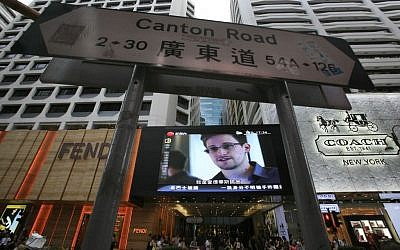A TV screen shows a news report of Edward Snowden, a former CIA employee who leaked top-secret documents about sweeping U.S. surveillance programs, at a shopping mall in Hong Kong Sunday, June 23 (AP Photo/Vincent Yu)