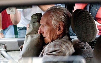 Alleged Hungarian war criminal Laszlo Csatary sits in a car as he leaves the Budapest Prosecutor's Office after he was questioned by detectives on charges of war crimes during WWII, on July 18, 2012. (photo credit: AP Photo/MTI, Bea Kallos)