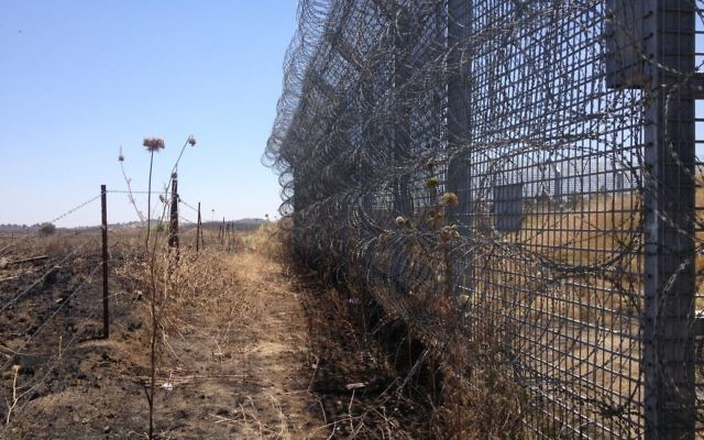 A section of Israel's new border fence, as seen from the Syrian side of the barrier (Photo credit: Mitch Ginsburg/ Times of Israel)