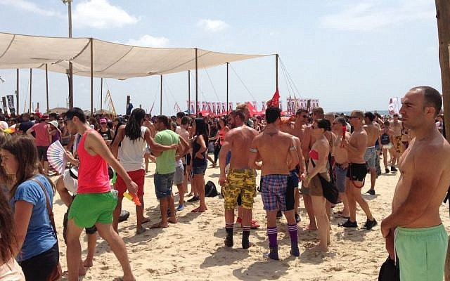 Revelers attend a beach party during the Tel Aviv Pride Festival on Friday (photo credit: Times of Israel staff)