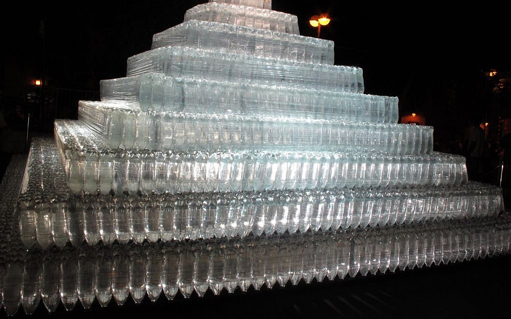 Nestled in Hurva Square, an illuminated pyramid titled 'Pyramid of Light,' by Heinz Kasper, is transparent and made of thousands of plastic bottles (photo credit: Leeor Bronis/Times of Israel)