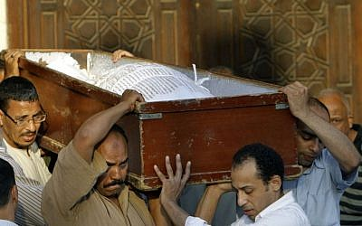 Egyptians carry the coffin of a Shiite following funeral prayers in Cairo, Egypt, Monday, June 24 (photo credit: AP/Amr Nabil)