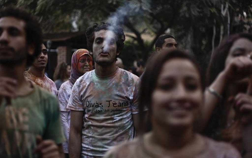 "Egyptian youths listen to music during a ""Mahraganat,"" Arabic word for ""festivals,"" concert, in Cairo, Egypt, in April (photo credit: AP/Nariman El-Mofty)"