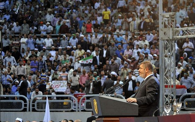 In this image released by the Egyptian Presidency, Egyptian President Mohammed Morsi addresses a rally called for by hardline Islamists loyal to the Egyptian president to show solidarity with the people of Syria, in a stadium in Cairo, Egypt, Sunday, June 15 (photo credit: AP/Egyptian Presidency)