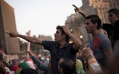 Men chant slogans against Egyptian President Mohammed Morsi during a demonstration in Tahrir Square in Cairo, Egypt, Wednesday, June 26 (photo credit: AP/Manu Brabo)