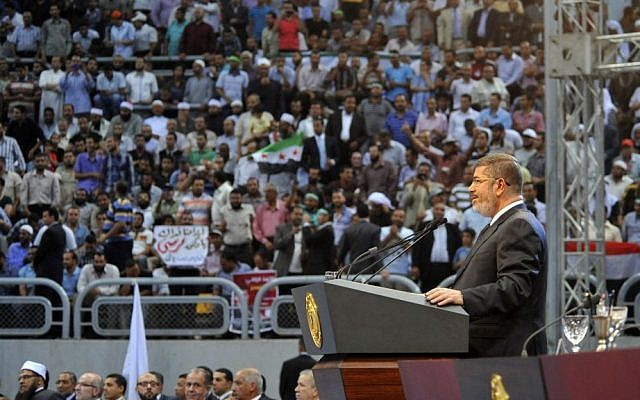 Egyptian President Mohammed Morsi addresses a rally called for by hardline Islamists loyal to the Egyptian president to show solidarity with the people of Syria, in a stadium in Cairo, Egypt, Sunday, June 15, 2013. (photo credit: AP/Egyptian Presidency)