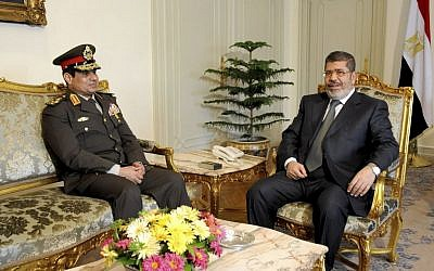 Egyptian Minister of Defense Lt. Gen. Abdel-Fattah al-Sisi meets with Egyptian President Mohammed Morsi at the presidential headquarters in Cairo, Egypt, on Thursday, February 21, 2013. (photo credit: AP/Mohammed Abd El Moaty, Egyptian Presidency)