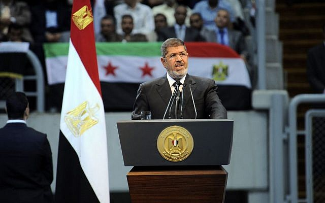 Egyptian President Mohammed Morsi addresses a rally called by hardline Islamists to show solidarity with the people of Syria, in a stadium in Cairo, Sunday, June 15, a day after he announced that he was cutting off diplomatic relations with Syria. (photo credit: AP Photo/Egyptian Presidency)