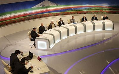 Iranian presidential candidates from right, Mohammad Gharazi, Mohammad Reza Aref, Saeed Jalili, Ali Akbar Velayati, Gholam Ali Haddad Adel, Hasan Rowhani, Mohammad Bagher Qalibaf, and Mohsen Rezaei, attend a TV debate in a state-run TV studio, in Tehran, Iran. (AP Photo/Islamic Republic of Iran Broadcasting, Mehdi Dehghan)