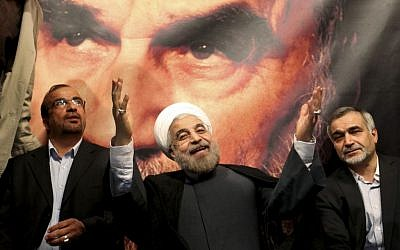 Hasan Rowhani gestures to his supporters at a rally in Tehran on June 1. (photo credit: AP/Ebrahim Noroozi)