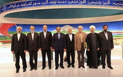 In this photo released by the Islamic Republic of Iran Broadcasting, on Friday, May 31, 2013, presidential candidates from left, Saeed Jalili, Gholam Ali Haddad Adel, Mohammad Bagher Qalibaf, Ali Akbar Velayati, Mohammad Gharazi, Mohammad Reza Aref, Hasan Rowhani, Mohsen Rezaei, pose for a group picture, after their TV debate in a state-run TV studio, in Tehran, Iran (photo credit: AP/Islamic Republic of Iran Broadcasting, Mehdi Dehghan)