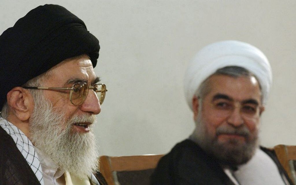 Iran's Supreme Leader Ayatollah Ali Khamenei, left, speaks during a meeting with Hasan Rouhani in Tehran, Iran, on June 16, 2013 (photo credit: AP/Office of the Supreme Leader)