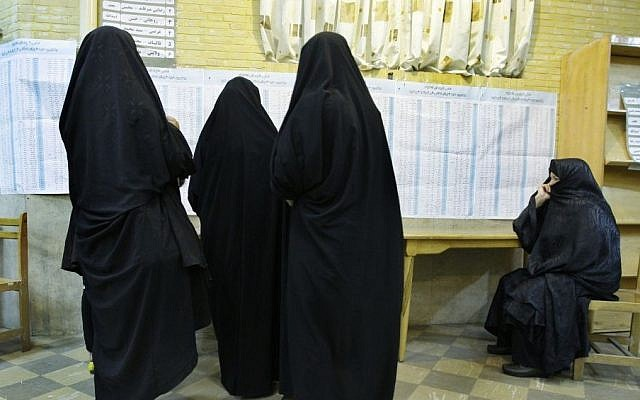 Head-to-toe veiled Iranian women attend a polling station to vote for the presidential and municipal councils elections in Tehran, Iran, Friday, June 14, 2013. (AP Photo/Vahid Salemi)