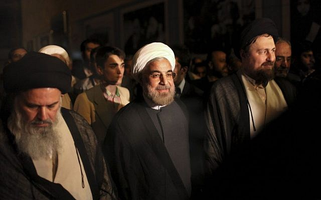 Iranian President elect Hasan Rowhani, center, is accompanied by Hasan Khomeini, grandson of the late revolutionary founder Ayatollah Khomeini, right, and Ayatollah Mousavi Bojnourdi, during visit of Ayatollah Khomeini's shrine, just outside Tehran, Iran, Sunday, June 16, 2013 (photo credit: Ebrahim Noroozi/AP)