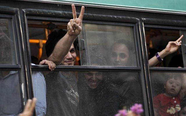 Passengers in a public bus flash victory signs in a reaction of supporters of the Iranian presidential candidate Hasan Rowhani, as they attend a celebration gathering in Tehran on Saturday. (photo credit: AP/Vahid Salemi)