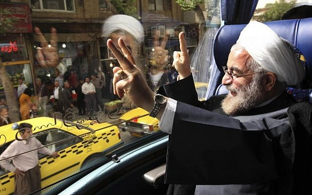 Then-presidential candidate Hassan Rouhani waves from a campaign bus in the western city of Sanandaj, Iran, earlier this year (photo credit: AP/Vahid Salemi)