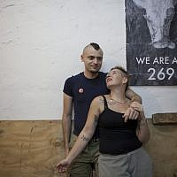 Israeli activists Sasha Boojor and Tal Gilboa are seen during a gathering of activists for Animal rights in a club in Tel Aviv, Wednesday, June 26, 2013 (photo credit: AP/Dan Balilty)