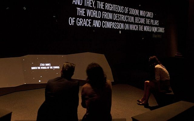 Visitors and reporters are seen at a new exhibition dedicated to those who saved Jews during WWII at the Yad Vashem Holocaust memorial in Jerusalem, Wednesday, June 26 (photo credit: AP/Sebastian Scheiner)