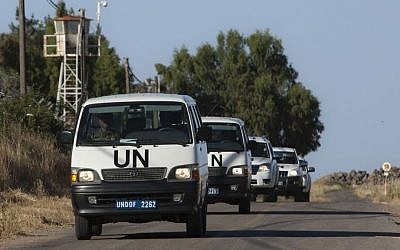 UN vehicles drive into a UN base near the Quneitra crossing between Israel and Syria, Friday, June 7, 2013 (photo credit: AP/Sebastian Scheiner)