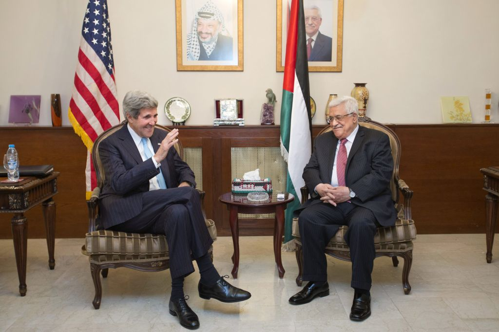 U.S. Secretary of State John Kerry, left, meets with Palestinian President Mahmoud Abbas in Amman, Jordan, on Friday, June 28, 2013 (photo credit: AP/Jacquelyn Martin, Pool)