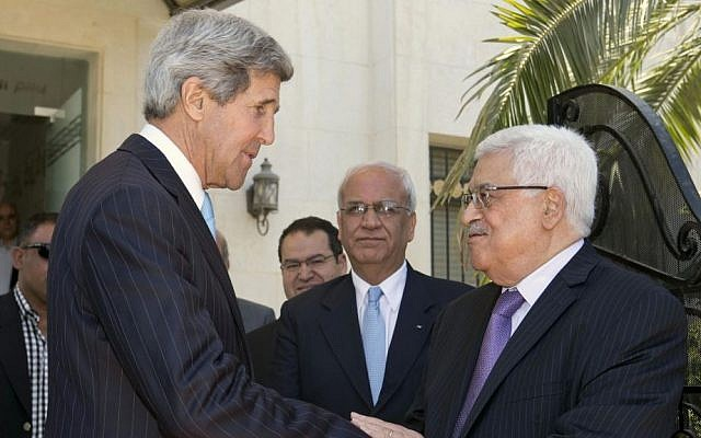 US Secretary of State John Kerry, left, says goodbye to Palestinian Authority President Mahmoud Abbas after a meeting in Amman in June 2013 (photo credit: AP/Jacquelyn Martin)