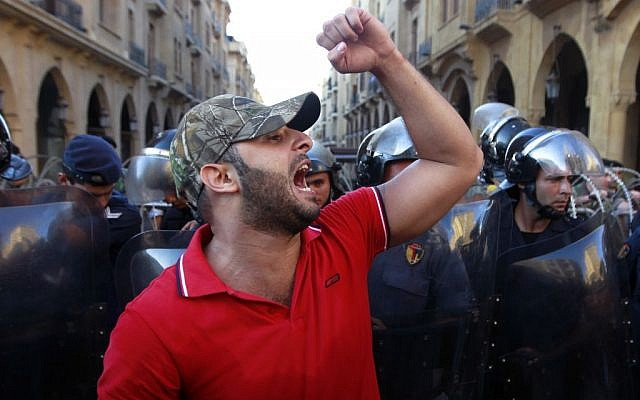 A civil society protester chant slogans against Lebanese lawmakers during a demonstration protesting the extension of parliament's mandate, near Parliament in Beirut, Lebanon, Friday, June 21, 2013. (photo credit: AP/Bilal Hussein)
