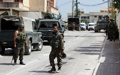 Lebanese Army soldiers during clashes that erupted between followers of a radical Sunni cleric Sheik Ahmad al-Assir and Shiite gunmen in Sidon, Lebanon, Monday, June 24 (AP Photo/Bilal Hussein)
