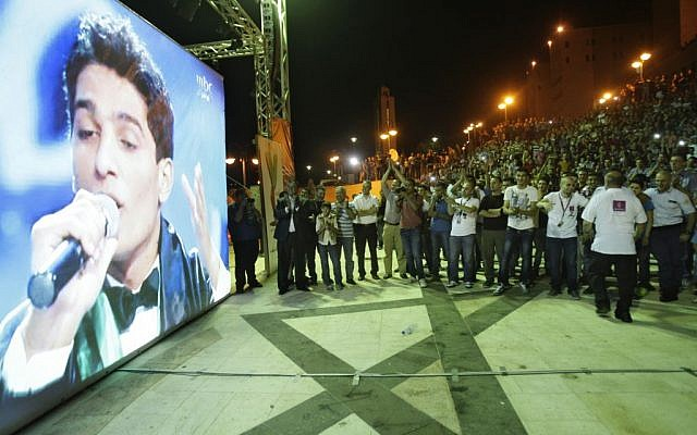 Palestinians watch the performance singer Mohammed Assaf, a contestant 'Arab Idol'  in the West Bank city of Nablus, on Saturday, June 21, 2013. (photo credit: AP Photo/Nasser Ishtayeh)