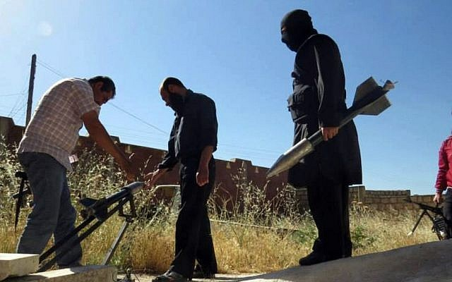 Syrian rebels prepare to fire locally made rockets in Idlib province, northern Syria (photo credit: AP/Edlib News Network ENN)