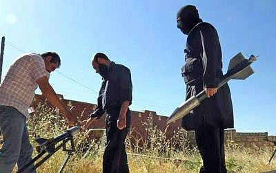 Syrian rebels preparing to fire locally made rockets, Tuesday, June 4, 2013 (photo credit: AP/Edlib News Network ENN)