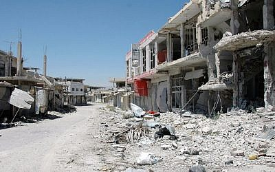FILE -- In this June 5, 2013 file photo released by the Syrian official news agency SANA, a damaged street is seen in Qusair, Syria. Syria's civil war has morphed into a proxy fight in which Shiite Iran has strongly backed Assad, while Sunni Arab nations have backed rebels. (Photo credit: AP/SANA)