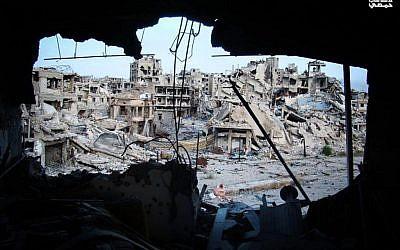 Damaged buildings in the Jouret al-Chiyah neighborhood of Homs, May 2013. (photo credit: AP/Yong Homsi Lens)