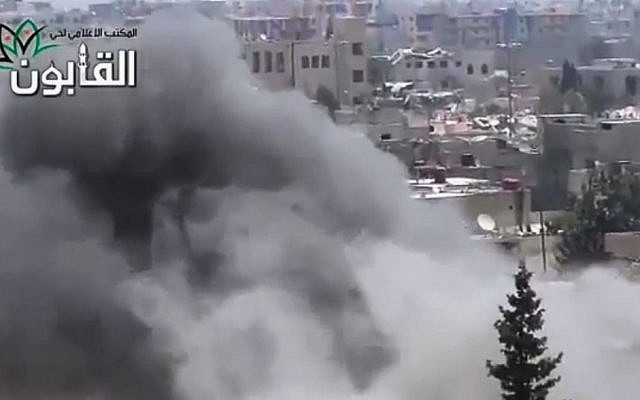 This image made from amateur video released by Ugarit News, which has been authenticated based on its contents and other AP reporting, shows smoke rises in Damascus, Syria, Friday, June 21, 2013. (Photo credit: AP/Ugarit News via AP video)