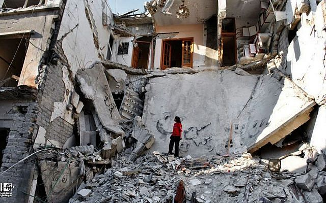 A Syrian standing in the rubble of destroyed buildings from Syrian forces shelling, Syria, Thursday, June 27, 2013. (photo credit:AP/Lens Young Homsi)