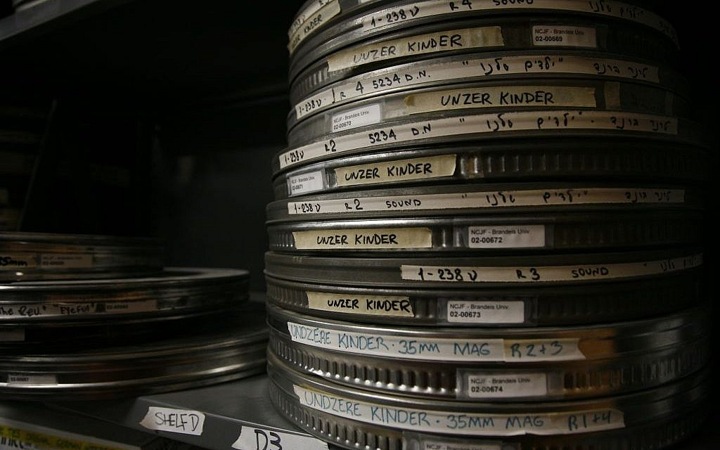 Several of the 15,000 reels of film owned by NCJF, the world's largest archive of Jewish-content film, outside of Israel. Shown here are 35mm reels of the 1948 Polish Yiddish feature 'Unzere Kinder' (Our Children), starring comedians Dzigan & Shumacher with child Holocaust survivors. (photo credit: courtesy National Center for Jewish Film)