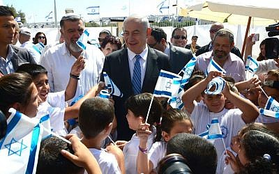 Prime Minister Netanyahu in the West Bank settlement of Barkan, June 25, 2013 (photo credit: courtesy GPO)