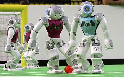 Robots in the 'standard platform' division compete at the RoboCup championships in Eindhoven, Netherlands, on June 27, 2013.  (photo credit: AP/Toby Sterling)