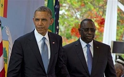 US President Barack Obama and Senegalese President Macky Sall leave after a news conference at the Presidential Palace in Dakar, Senegal Thursday, June 27, 2013 (photo credit: AP Photo/Evan Vucci)