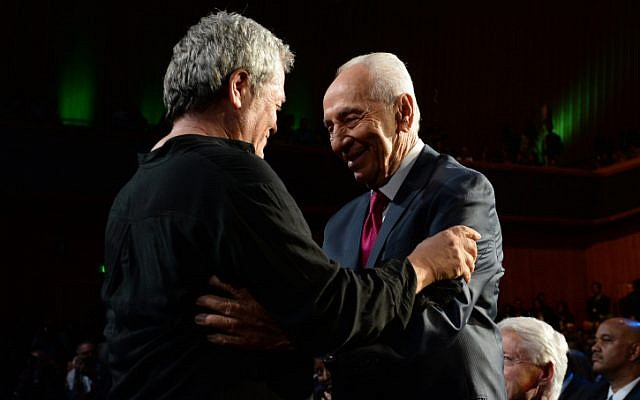 Israeli singer Shlomo Artzi congratulates Israeli President Shimon Peres after performing at a celebration in honor of Peres's 90th birthday, in Jerusalem, June 18, 2013. (photo credit: Kobi Gideon/GPO/Flash90)