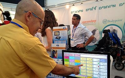 Yossi Blum, the creator of D-bur, a communications software program for the speech impaired, tests his product at the Ezertech convention held at the Israel Trade and Convention Center in Tel Aviv. (photo credit: Courtesy)