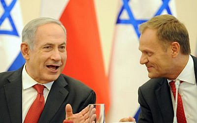 Prime Minister Benjamin Netanyahu, left, and his Polish counterpart Donald Tusk in Warsaw, Poland, on Wednesday, June 12, 2013. (photo credit: AP Photo/Alik Keplicz)