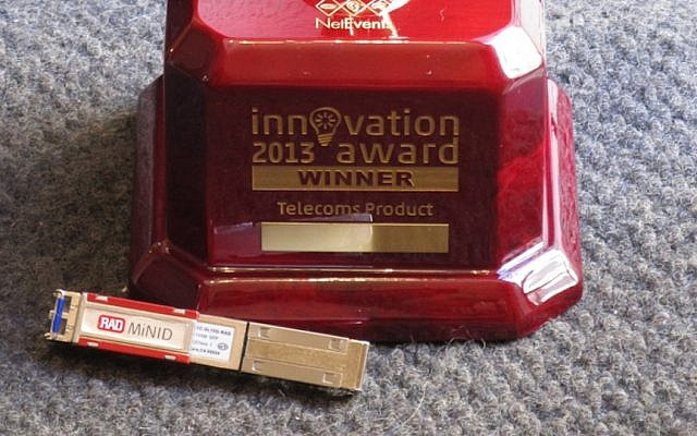 RAD Data's MiNID device, together with its innovation award (Photo credit: Courtesy)