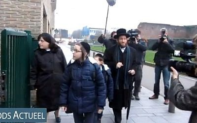 Rabbi Moshe Aryeh Friedman and his family arrive at the Yesode Hatora School in Antwerp, Belgium (photo credit: YouTube screenshot/File)